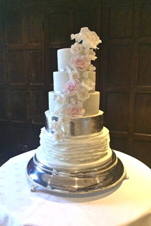 5 Tier sugar rose, ruffle and silver leaf cake at Great Fosters