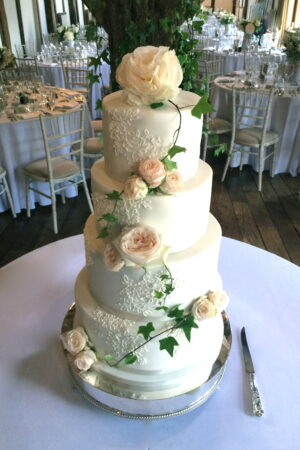 Featuring fresh roses and piped alencon lace at Loseley Park