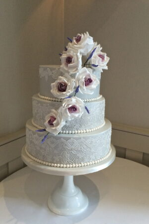 Blush sugar roses & lavender with dove grey & edible lace at Wotton House