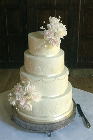 Sugar rose & pearl sprays with Alencon lace at Great Fosters