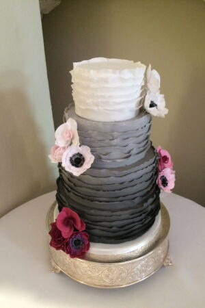 Grey Ombre Ruffle Cake with Ombre Sugar Roses, Orchids & Peonies at Farnham Castle