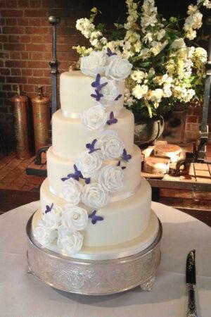 Sugar rose & butterfly cascade cake