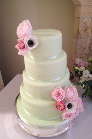 Four tier mint cake with sugar peonies, roses, anemones & ranunculus - at Farnham Castle