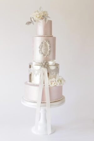 Brushed pink lustre with silver leaf, sugar roses & monogram. www.gillflettlifestyle.com
